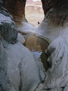 Hiker Exploring the Silver Grotto at Mile 29 of the National Canyon by Bobby Model