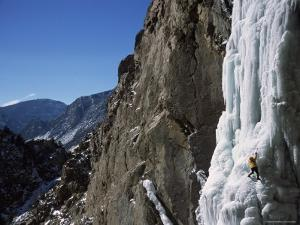 Male Ice Climbing in the Clark's Fork Canyon, Wyoming by Bobby Model