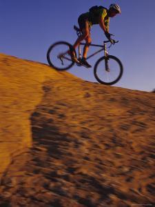 Male Mountain Biking Slickrock in Wyoming by Bobby Model