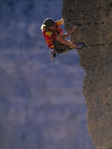 Man Rock Climbing in Wyoming by Bobby Model