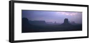 Panoramic View at Dusk of Monument Valley Rock Formations by Bobby Model