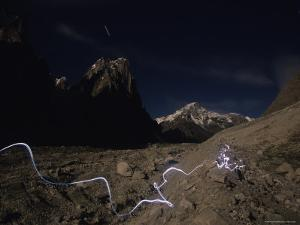 Trail of Light from Headlamp Along the Trango Glacier in Pakistan by Bobby Model