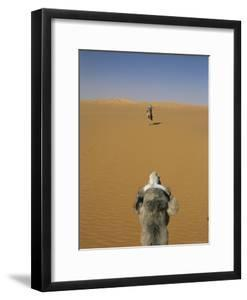 Tuareg Guide on a Camel Photographed From the Back of a Camel by Bobby Model