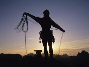 Women Coils a Climbing Rope in the Mountains of Idaho by Bobby Model