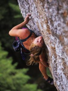 Women Makes a Move on a Rock Climb in Wyoming by Bobby Model