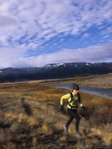Women Trail Running in Yellowstone National Park, Wyoming by Bobby Model