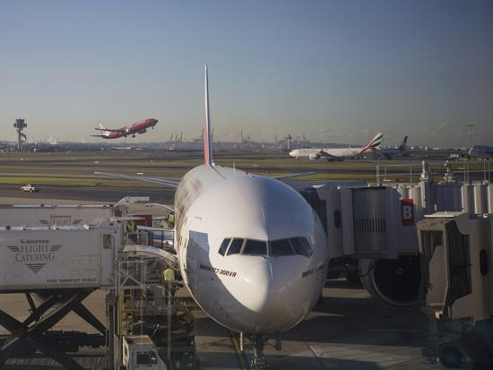 Boeing 777-300 ER Jet Airliner of Emirates Airline at Gate, Sydney Airport, Australia-Nick Servian-Photographic Print
