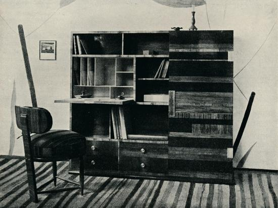 'Bookcase and Chair. Designed and executed by Hans Hartl', c1927-Unknown-Photographic Print