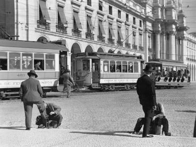 Bootblacks at Work in Front of the Ministry of Marine on the Praca Do Comercio in 1936-W^ Robert Moore-Photographic Print