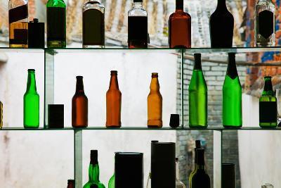 Bottles Displayed at Foreigner Bar, Old Town, Dali, Yunnan Province, China--Photographic Print