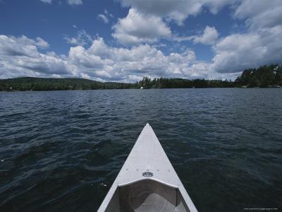 Bow of a Canoe Points Across Star Lake Toward the Horizon-Todd Gipstein-Photographic Print