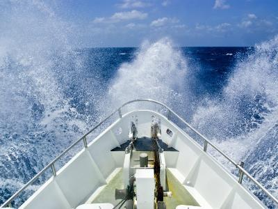 Bow of a Ship Ploughs Through Heavy Seas and Spray in Open Ocean-Jason Edwards-Photographic Print