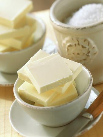 https://imgc.artprintimages.com/img/print/bowl-of-butter-and-a-pot-of-salt_u-l-q138ond0.jpg?p=0