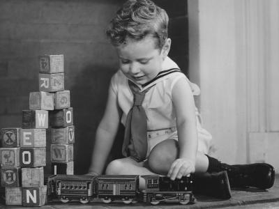 Boy (4-5) Playing With Model Train Set on Floor,-George Marks-Photographic Print