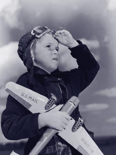 Boy (8-10) Wearing Flying Cap and Goggles Holding Toy Plane--Photographic Print