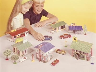 Boy and Girl (8-9) Playing With Doll Houses and Cars, Elevated View-George Marks-Photographic Print