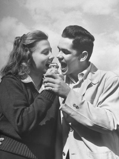 Boy and Girl Eating an Ice Cream Cone Together-Ed Clark-Premium Photographic Print