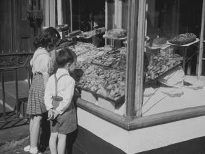 Boy and Girl Looking in at Bakery Window