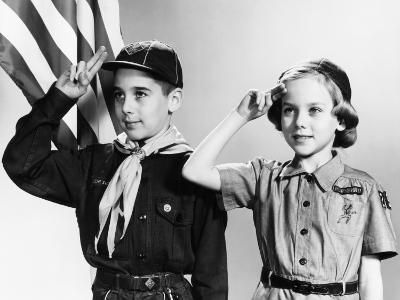 Boy and Girl Scouts Saluting, American Flag in Background-H^ Armstrong Roberts-Photographic Print