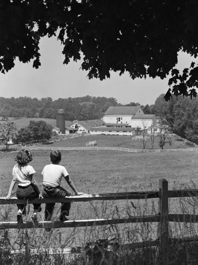 Boy and Girl Sitting on Fence, Overlooking Farm Fields-H^ Armstrong Roberts-Photographic Print