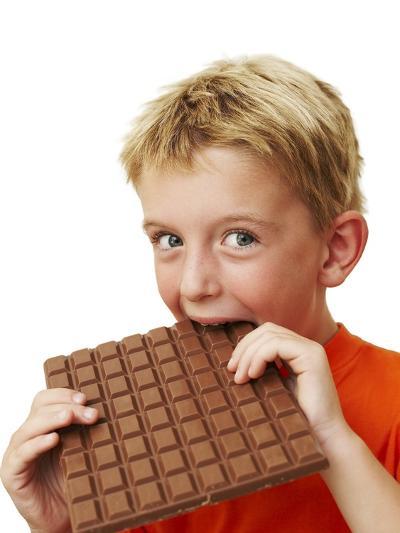 Boy Eating Chocolate-Ian Boddy-Photographic Print
