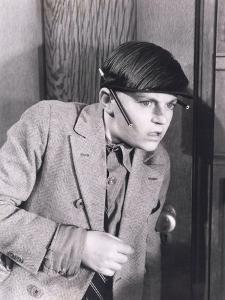 Boy Eavesdropping at Door