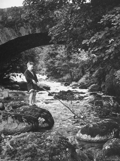 Boy Fishing by the Bridge over the Laroch in Ballachulish-Hans Wild-Photographic Print
