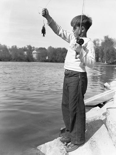 Boy Holding a Small Fish-Philip Gendreau-Photographic Print