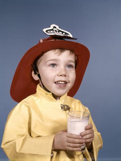 Boy in Fireman Costume Holding Glass of Milk-H^ Armstrong Roberts-Photographic Print