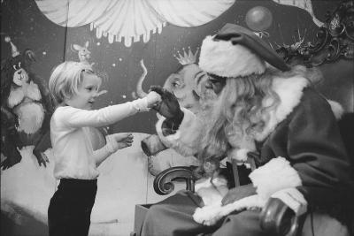 Boy Kissing African American Santa Claus in Unidentified Department Store. 1970-Ralph Morse-Photographic Print
