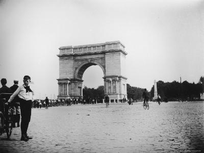 Boy on Bike as Hundreds Ride Bikes Through the Arch at Prospect Park During a Bicycle Parade-Wallace G^ Levison-Photographic Print
