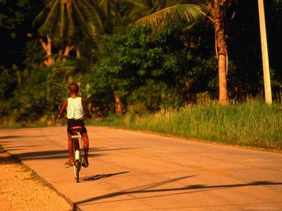 Boy Riding Bike on Dirt Road, Ko Samui, Surat Thani, Thailand-Dallas Stribley-Photographic Print