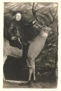 Boy Riding Stuffed Deer