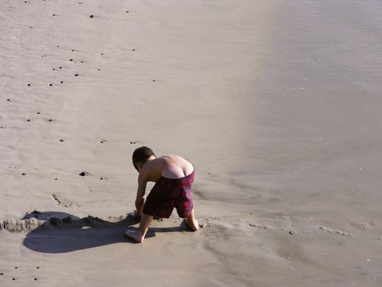Boy's Bottom Peeks Out from His Bathing Suit as He Plays in Sand-White & Petteway-Photographic Print