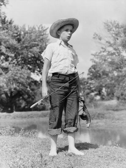 Boy Wearing Straw Hat and Holding a Fishing Rod, Standing Barefoot By River-H^ Armstrong Roberts-Photographic Print