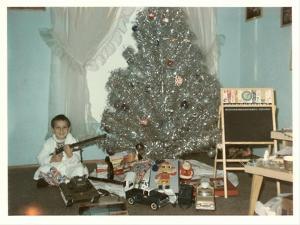 Boy with Gun and Fake Christmas Tree