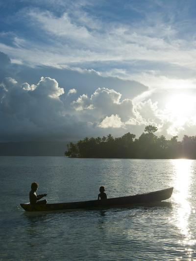 Boys in a Canoe in Backlit in the Marovo Lagoon, Solomon Islands, Pacific-Michael Runkel-Photographic Print