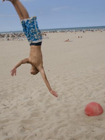 https://imgc.artprintimages.com/img/print/boys-jumping-at-las-arenas-beach_u-l-pxtrar0.jpg?p=0