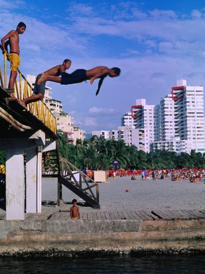 Boys Jumping from Bridge in El Rodadero, Seaside Suburb of Santa Marta, Colombia-Krzysztof Dydynski-Photographic Print