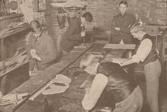 Boys of Harrow School making splints, crutches and other articles for the wounded, c1916-Unknown-Photographic Print