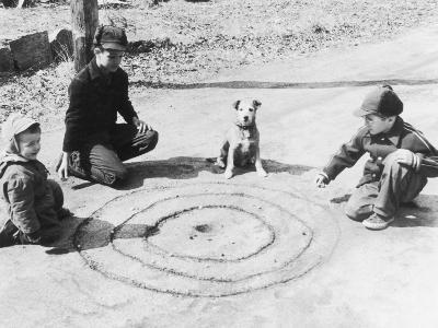 Boys Playing Marbles, Dog Watching--Photographic Print