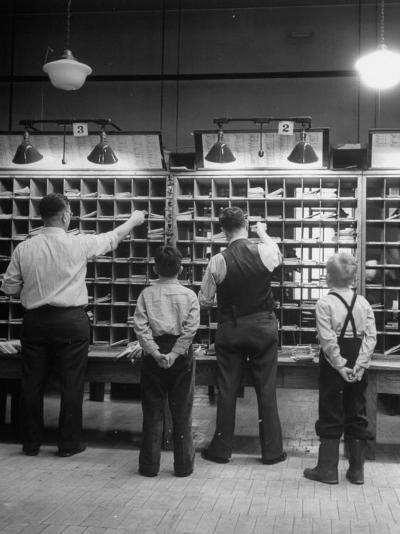 Boys Watching Postal Workers Sorting Mail-Nina Leen-Photographic Print