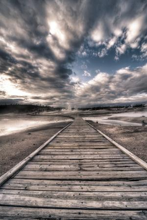 Yellowstone, Wyoming: a Wooden Path Going Through Norris Geyser Basin on a Cloudy Sunset