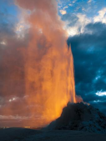 Yelowstone, Wy: White Dome Geyser Erupting with the Sun Setting Behind It