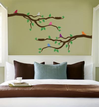 Branch With Multi-Colored Birds