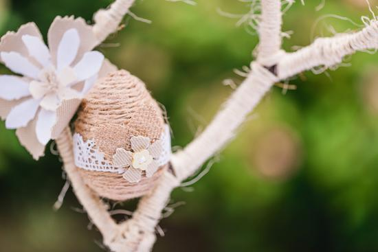 Branch, wrapped, jute cord, blossoms, Easter egg, close up,-mauritius images-Photographic Print