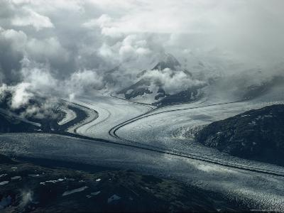 Branches of a Glacier Join Together Below Cloud-Covered Peaks-George F^ Mobley-Photographic Print