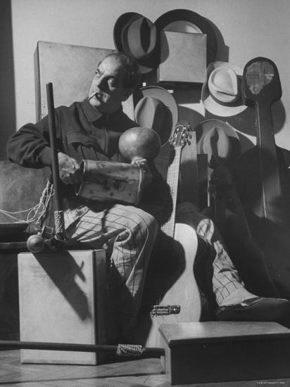 Brazilian Composer Heitor Villa Lobos Playing Native Brazilian Folk Instrument from His Collection--Premium Photographic Print