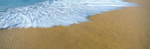 Breaking wave creates feather patterns at Playa La Cachora, Todos Santos, Baja California Sur, M...