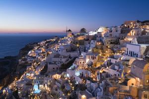 Greece, Santorini. The village of Oia glows in the post-sunset light. by Brenda Tharp